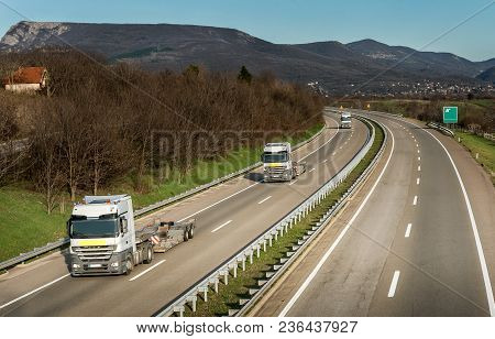 Convoy Of Semi Trucks Without Trailers In Country Highway Traffic
