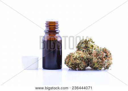 Medicinal Marijuana Cannabis With Extract Oil In A Bottle. Cannabis Cbd Oil Hemp Products. Cannabis