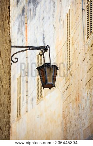Malta, Mdina. Old Lantern Lamp In The Medieval City With The Narrow Streets And Houses Limestone Fac