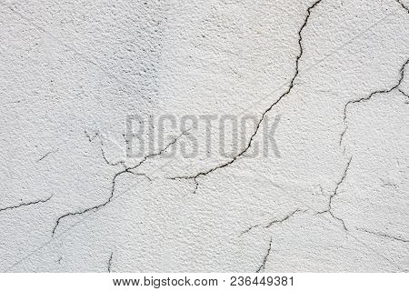 Texture Of White Dirty Cracked Wall. Small Straight Cracks. Direct Fracture On Painted Surface. Cell