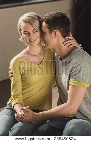 View Of Boyfriend Kissing Girlfriends Neck At Home