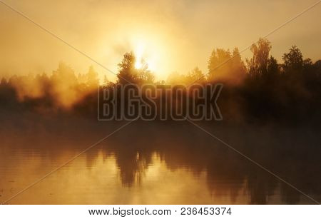River and solar fog. Early morning with sunrise. Backlighting