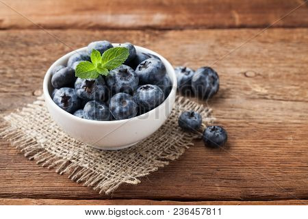 Blueberry On Wooden Table Background. Ripe And Juicy Fresh Picked Blueberries Closeup. Berries Close