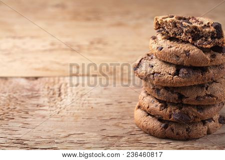 Cookies With Chocolate Chips On A Wooden Table. With Copy Space.
