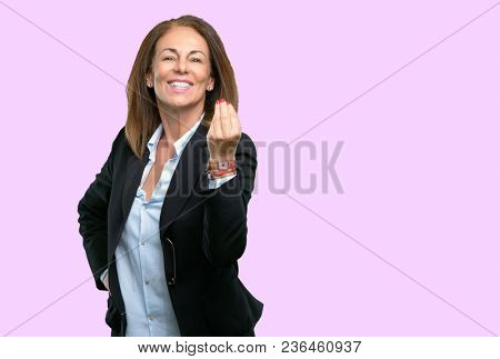 Middle age business woman angry gesturing typical italian gesture with hand, looking to camera