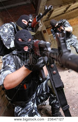 Soldiers In Black Masks Targeting With Guns