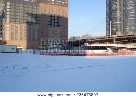 Construction Site Of The Chicago Spire Super Tall Skyscraper In Winter Surrounded By Snow Under A Bl