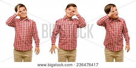 Handsome toddler child with green eyes looking at camera through fingers in ok gesture. Imitating binoculars, beautiful eyes and smile