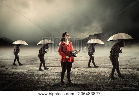 People With Umbrella Walking In A Row  And One Noticed It Was Not Raining.the Concept Of Positivity