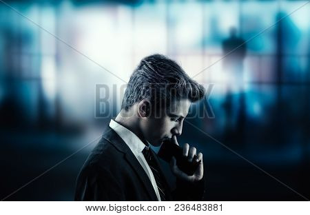 Thoughtful Bussinessman With A Phone And A City View Suggesting A Very Important Decision