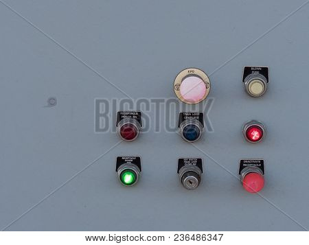 Switches And Toggles On A Control Panel Flashing Various Lights And Labels