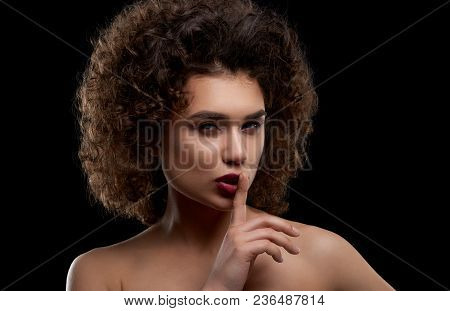 Charismatic Curly Model Posing On Black Background. Girl Having Intresting Hairstyle With Many Curle