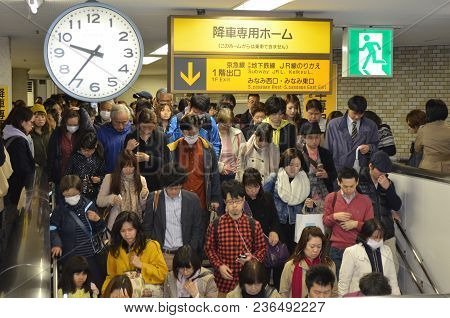 An Image Of Japanese People In A Japanese Train Station Captured On April 20, 2013.