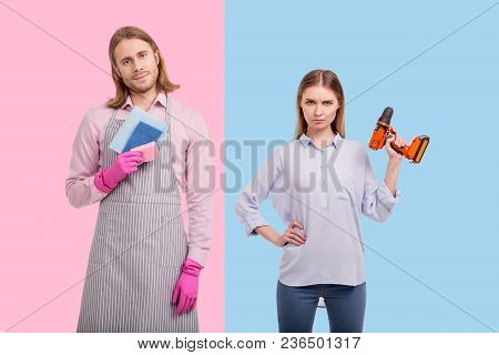No Gender Stereotypes. Pretty Young Woman Lifting Up A Screw Gun And Posing With It While Her Boyfri
