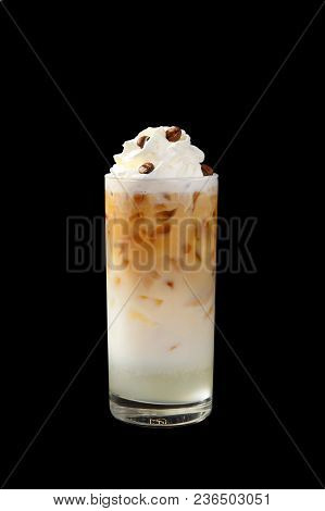 A Multi-colored, Two-layer Opaque Cocktail In A Tall Glass With Chopped Ice, Whipped Cream And Coffe