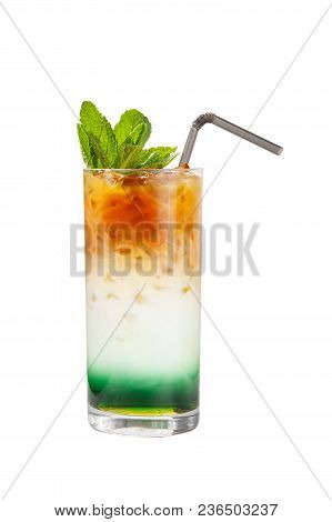 A Multi-colored, Three-layered Cocktail In Glass With Crushed Ice And Mint Leaves And Coffee Beans,