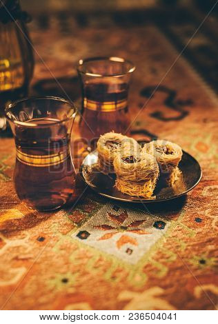 Middle Eastern sweet Baklava served with Arabic tea. Arabic food and cusine food photography.