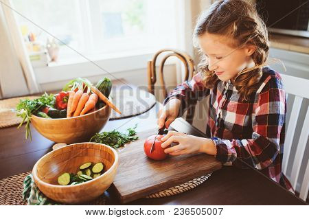 Child Girl Helps Mom To Cook And Cut Fresh Vegetables For Salad With Knife. Kids Learning House Work