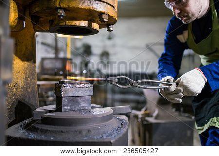 The Brutal Man Works In The Workshop