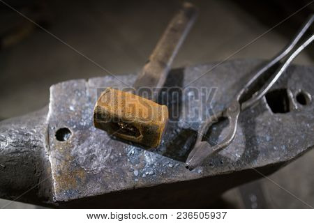 Hammer And Forceps Lie On The Anvil