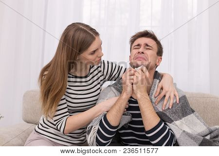 Come Down Sweetie. Emotional Caring Woman Touching Her Boyfriend On The Shoulder And He Crying