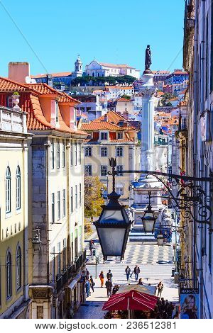 Lisbon, Portugal - March 27, 2018: Aerial Scenic View Of Street Leading To Rossio Square, Row Of Lan