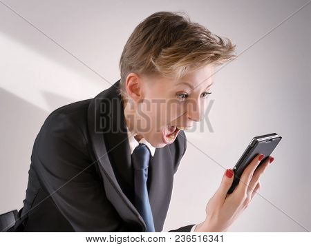 Annoyed Business Woman Screaming In Anger Into Smart Phone