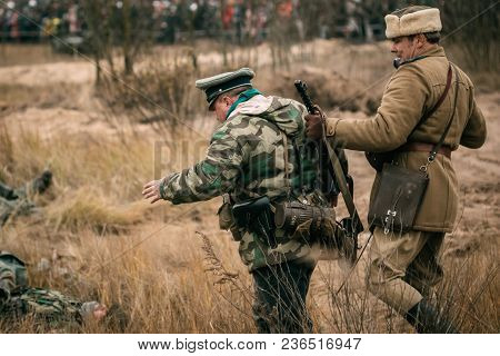 Gomel, Belarus - November 26, 2017: The Soviet Officer Of The Red Army Captured A German Soldier. Re