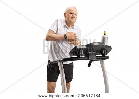 Mature man on a treadmill having a heart attack isolated on white background