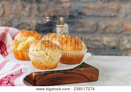 Savory Double Cheese Muffins On A Wooden Board. White Stone Background.