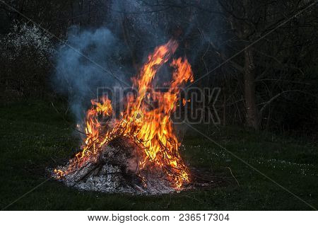 Night Fire From Burning Dry Twigs Closeup On Rural Farm Meadow