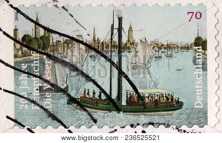 Luga, Russia - February 08, 2018: A Stamp Printed By Germany Shows Famous Steamboat Weser - The Firs