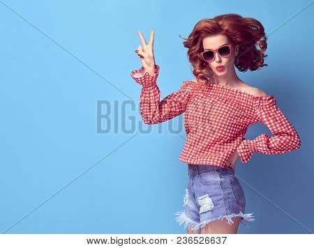 Young Sexy Pinup Redhead Girl Blowing Lips Showing Peace Sign. Fashion Playful Woman Having Fun On B