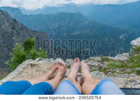Loving Couple Resting On The Top Of The Mountain After Climbing