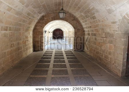 Lattice At The End Of The Tunnel Consisting Of Lined Arches