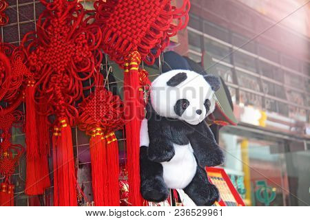 Red Silk Tassels With Chinese Traditional Decorative Knots And Panda Toy Hang Together