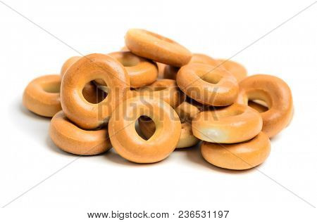 Large pile of bagels on white background