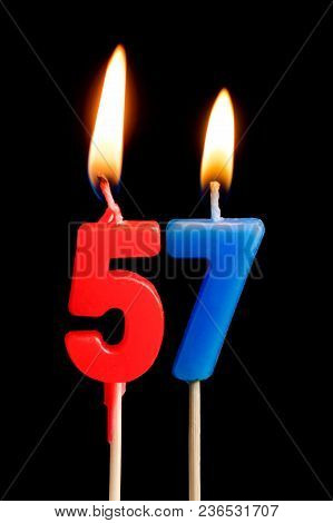 Burning Candles In The Form Of 57 Fifty Seven (numbers, Dates) For Cake Isolated On Black Background