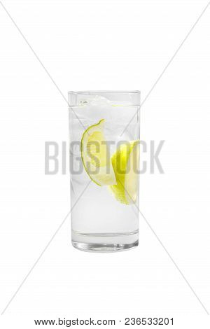 Transparent Cocktail In A Tall Glass With Ice Cubes With Two Slices, Lime Quart, Soda, Aeration. Sid