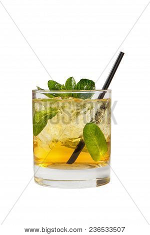 Transparent One-color Cocktail In A Low Glass With Crushed Ice Frappe With Mint Leaves With Melon, P