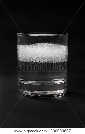 Monochrome Transparent Cocktail, Soda, Foam, Boom, In A Low Glass. Side View Isolated Black Backgrou