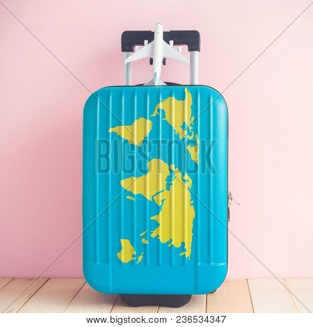 Suitcase With World Map And Airplane Model Toy Against Pastel Pink Wall Minimal Travel Vacation Crea