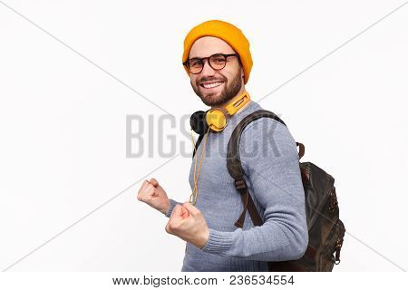 Side View Of Cheerful Man In Hat And Glasses Wearing Backpack And Holding Fists Up Celebrating Succe