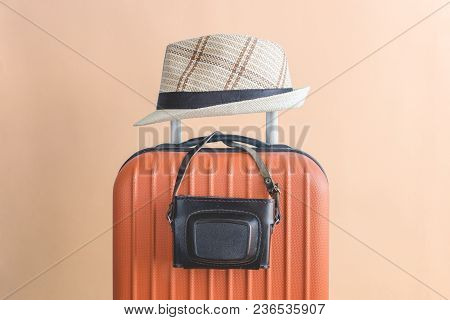 Suitcase With Hat And Retro Camera. Travel Equipment Minimal Creative Concept.