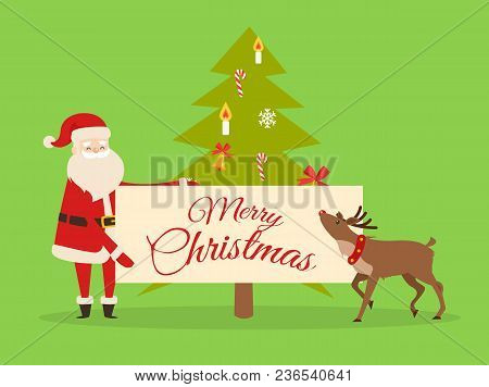 Christmas Banner In Santas Hand On Background Of New Year Fir Tree. Father Frost With Big Billboard