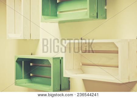 Empty Green And White Wooden Shelves On The Wall