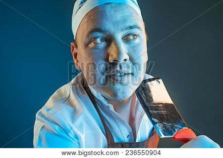The Anger And Screaming Cook Man. Hate, Rage. Crying Emotional Angry Man In Colorful Bright Lights A