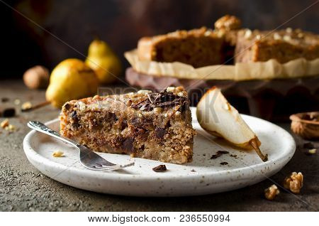 Pear Pie With Walnuts And Chocolate Chips On Old Stone Background