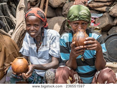 Omo, Ethiopia - September 2017: Unidentified Ethiopian Women Chatting And Drinking In Their Village.