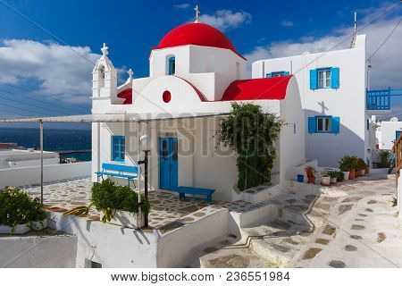 Traditional Church With Red Dome And Whitewashed Facade, Typical Greek Church Building On The Island